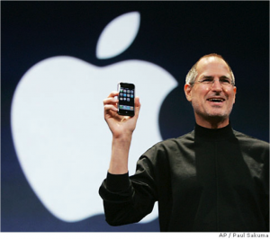Steve Jobs holding iPhone smiling