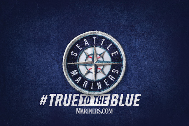 Mariners 'True to the Blue' logo with 'rhombus' text styling